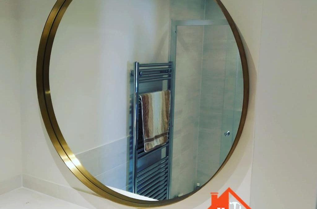 Heavy brass mirror hanged in Reading