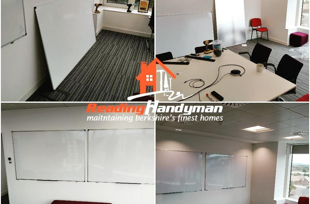 5 whiteboards hanged and office desks assembled
