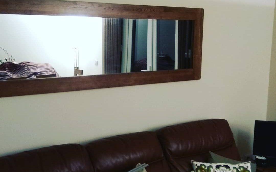 Oak framed mirror hanged in Kennet Island, Reading